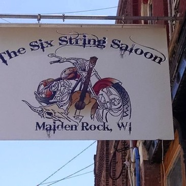 https://www.facebook.com/The-Six-String-Saloon-190054193461/