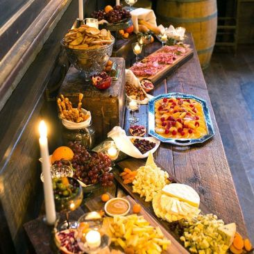 Rustic Appetizer Display- Collection of crates, wooden platters, silver platters and pedestal stands