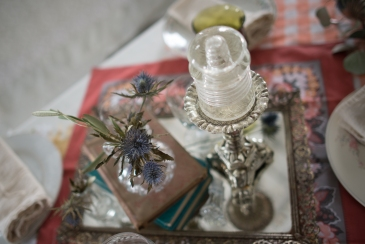 Mirror Tray with eclectic mix of books, bud vases and candlesticks